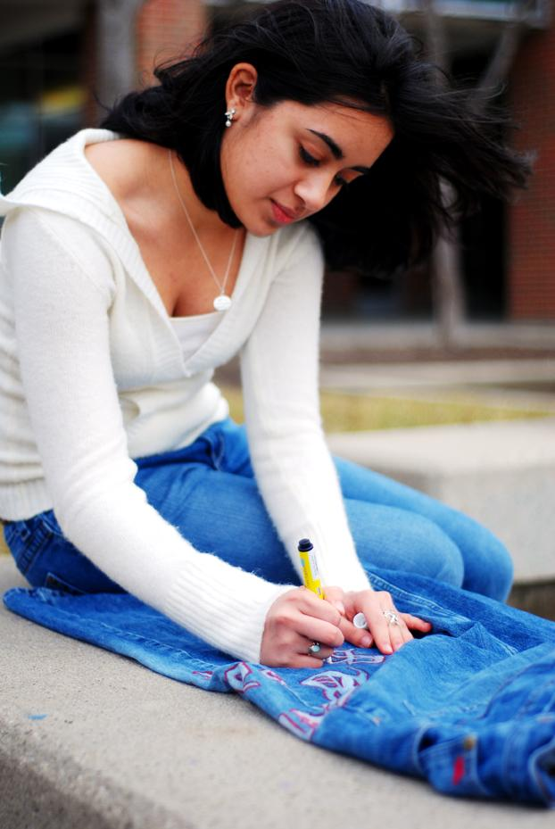 House of Kamath: Sophomore Aneesha Kamath works on designing a par of jeans. She was inspired by the jeans on the cover of popular book series Sisterhood of the Traveling Pants.