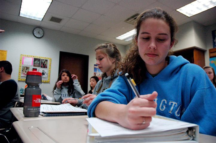 TEST JITTERS: Junior Kelley McGill fills out a review packet for an upcoming Spanish test. McGill has had terrible cases of nerves before exams since elementary school.
