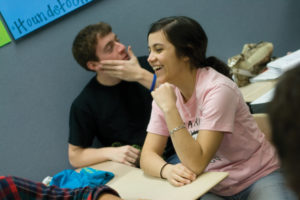 NOTIFIED: Senior Sophia Paliza-Carre talks to her ex-boyfriend. Although she posted her breakup with him on Facebook, Paliza-Carre said she would not post her relationship on Facebook again because she wants to keep some aspects of her life personal. MEHER AHMAD / PHOTO