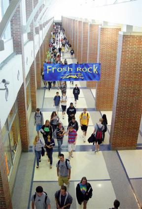 SWIMMING UPSTREAM: During a passing period, students pass through the main hallway on their way to class. Many students here have found it easier to transition to college from a large school like CHS. SARA ROGERS / PHOTO