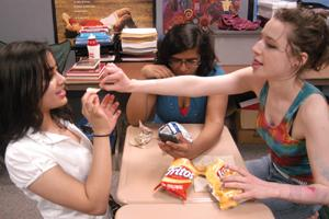 chit chat: Junior Aneesha Kamath (left) shares food and chats with her friends, juniors Saumya Saukhararam and Eve Eggleston. Kamath said that she doesn't like to stereotype against people. JINNY ZHANG / PHOTO
